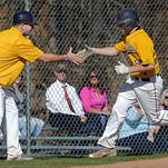 Pittsford Sutherland's Alec Vaules, right, is congratulated by coach Jim Capellupo after a two-run homerun during a regular season game played at Pittsford Sutherland High School on Wednesday, April 20, 2016. Pittsford Sutherland beat Honeoye Falls-Lima 14-5.