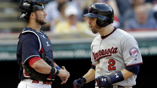 Minnesota Twins' Brian Dozier, right, celebrates as Cleveland Indians catcher Yan Gomes waits as Dozier runs the bases after a solo home run in the eighth inning of a baseball game, Saturday, June 24, 2017, in Cleveland.