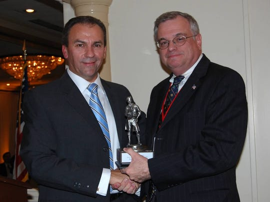 "More than 100 guests gathered at the Pines Manor in Edison on Nov. 5 to congratulate Roberto Muñiz, the recipient of the Distinguished Citizen Award from the Boy Scouts of America, Middlesex County Chapter. Muniz (left), president and CEO of Francis E. Parker Memorial Home, is shown receiving the award from Event Chairman Garrick Stoldt, CFO, Saint Peter's Healthcare System. With more than $80,000 raised, the event is the Middlesex County Boy Scouts' largest fundraiser. Proceeds will benefit many Scouting programs, as well as support camp and individual scholarships for the at-risk youth Scouting programs. ""I am pleased that funds raised for this event will help provide scouting opportunities throughout New Jersey,"" Muñiz said. ""It is vitally important to have Scouting programs available in communities large and small, urban and rural, and particularly for our at-risk youth."""