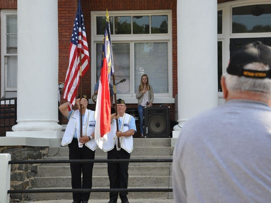 Eugene Ipox and Jim Seacord of the Western North Carolina Submarine Veterans served as color guards for Marshall's Memorial Day observance in 2017.