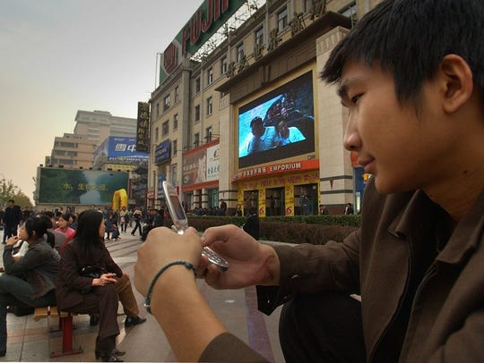 Cell phones have become essential in China's rapidly
