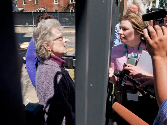 Lucinda Milne (left), grandmother of Brooke Bennett, speaks through a fence at the Federal Building on Tuesday, May 20, 2014 after seeing Michael Jacques sentenced to a life term plus 70 years for the 2008 murder of of her then 12-year-old granddaughter.