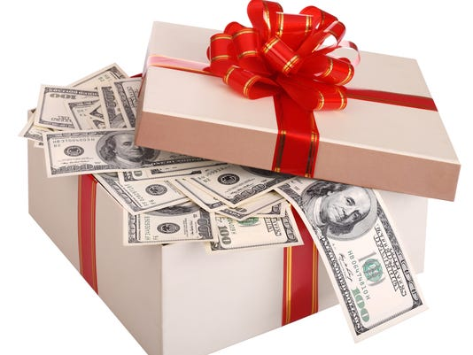 Gift box with banknote of dollar.