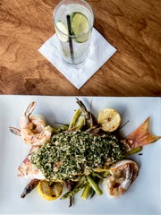 June 10, 2017 - Memphis, TN: Grilled porgy with gulf shrimp and asparagus served up at Sweetgrass in Cooper-Young.