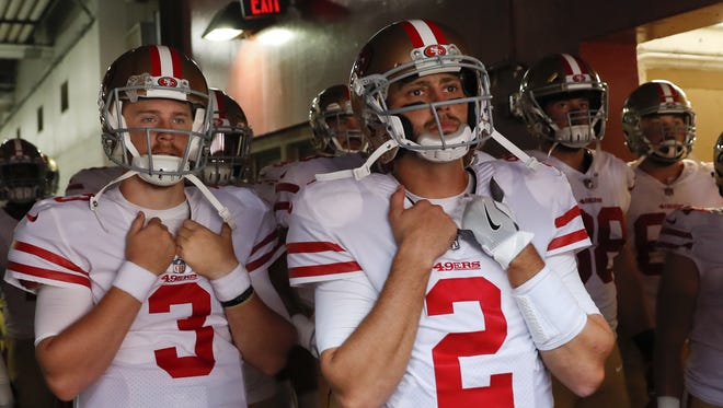 AP San Francisco 49ers quarterback Brian Hoyer (2) stands in the tunnel with his teammates before an NFL football game against the Washington Redskins in Landover, Md., Sunday, Oct. 15, 2017. (AP Photo/Alex Brandon)