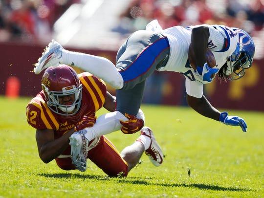Iowa State linebacker Jay Jones (12) trips up Kansas' Taylor Martin (24) Saturday, Oct. 3, 2015, at Jack Trice Stadium in Ames.