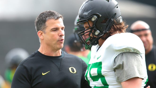 Apr 21, 2017; Eugene, OR, USA; Oregon Ducks offensive line coach Mario Cristobal talks with offensive lineman Evan Voeller (79) during spring practice at the Oregon Ducks outdoor practice facility. Mandatory Credit: Scott Olmos-USA TODAY Sports