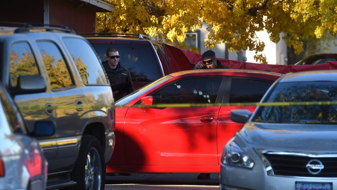 Police investigate a shooting at near the intersection of Parkview St. and Mazzone Ave. in Reno on Nov. 2, 2017.