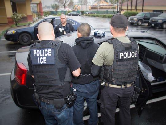 Immigration and Customs Enforcement officers arrest