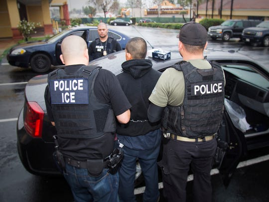 In this photo taken Feb. 7, 2017, released by U.S. Immigration and Customs Enforcement, an arrest is made during a targeted enforcement operation conducted by U.S. Immigration and Customs Enforcement (ICE) aimed at immigration fugitives, re-entrants and at-large criminal aliens in Los Angeles.