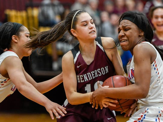 Henderson's Katie Rideout (10) is fouled by Christian