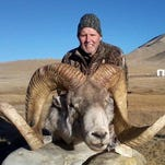 "This Dec. 2012 photo provided by Rick Vukasin shows Vukasin, 65, of Great Falls, Mont., posing with a rare argali sheep known as the ""Marco Polo'' that he shot in the Pamir mountains of northeast Tajikistan near Karakul Lake along the Chinese border."