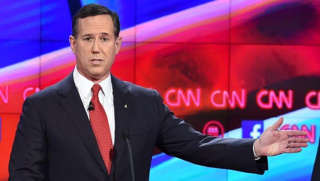 Rick Santorum gestures on stage during the undercard debate in Las Vegas on Dec. 15, 2015.