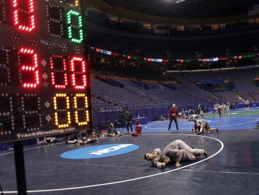 Iowa 165-pounder Nick Moore practices with 149-pounder