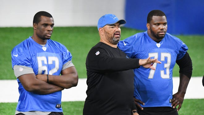 New Lions offensive linemen Cyrus Kouandjio, left, and Greg Robinson, right, listen at the team's mini-camp in June.