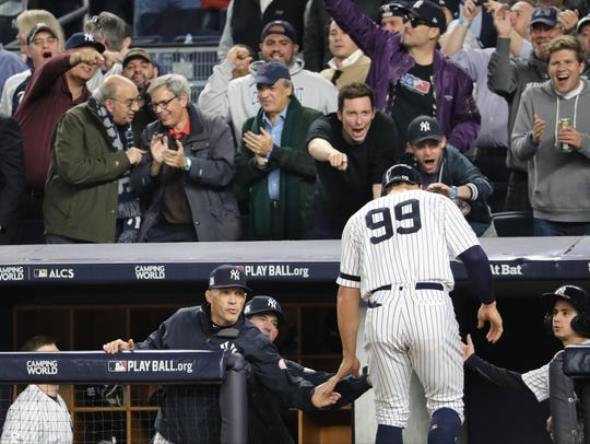 Yankee fans cheer for Aaron Judge (99) as he is congratulated