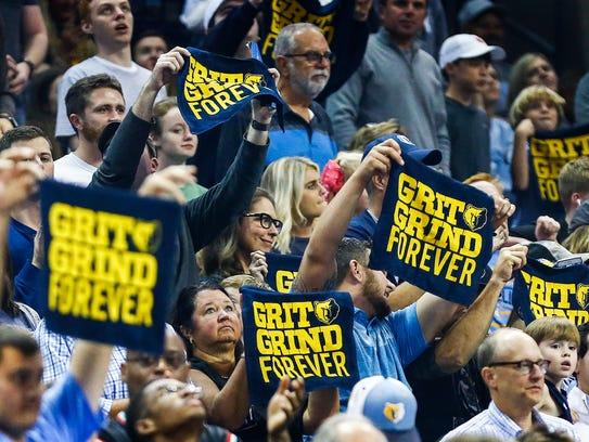 Memphis Grizzlies fans cheer during a break in action