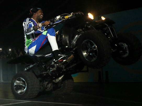 Meek Mill popped a wheelie as he rode onto the stage