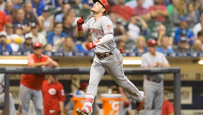 Aug 21, 2018; Milwaukee, WI, USA; Cincinnati Reds second baseman Scooter Gennett (3) reacts after hitting a home run during the ninth inning against the Milwaukee Brewers at Miller Park. Mandatory Credit: Jeff Hanisch-USA TODAY Sports