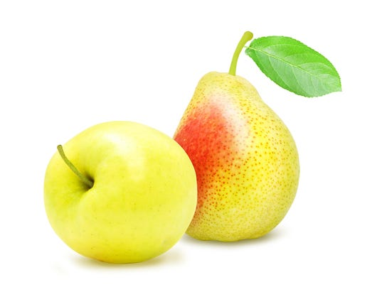 Apple and pear with green leaf.
