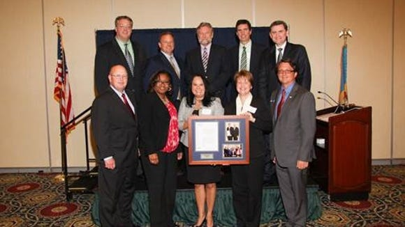 Chesapeake Utilities workers accept corporation of the year award from the Central Delaware Chamber of Commerce
