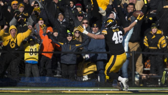 Iowa's George Kittle celebrates his 35-yard touchdown catch.