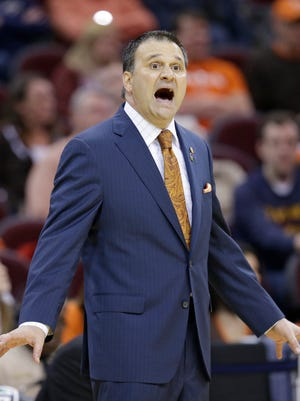 Bowling Green head coach Chris Jans yells to players during the first half of an NCAA college basketball game in the second round of the Mid-American Conference tournament Wednesday, March 11, 2015, in Cleveland.