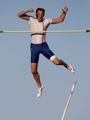 French pole vaulter Renaud Lavillenie clears the bar Wednesday, April 22, 2015, during the Drake Relays Street Vault along Court Avenue in Downtown Des Moines.