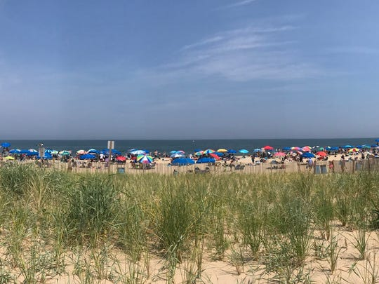 Umbrellas line Rehoboth Beach nearly two months after