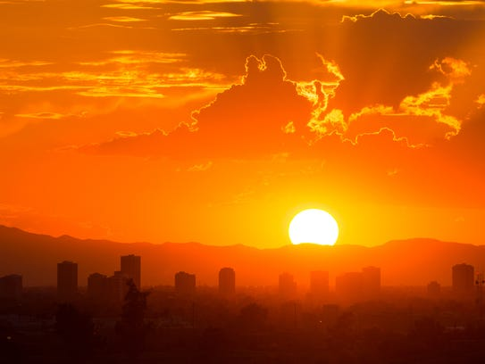 The sun sets behind downtown Glendale as seen from