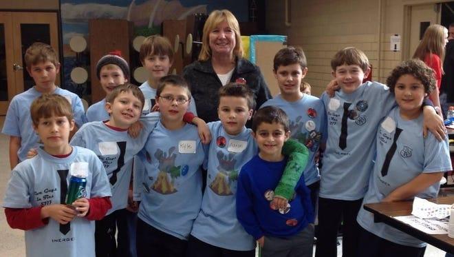 A very proud St. Rita principal Mary Ellen Wagner with both St. Rita Lego League teams