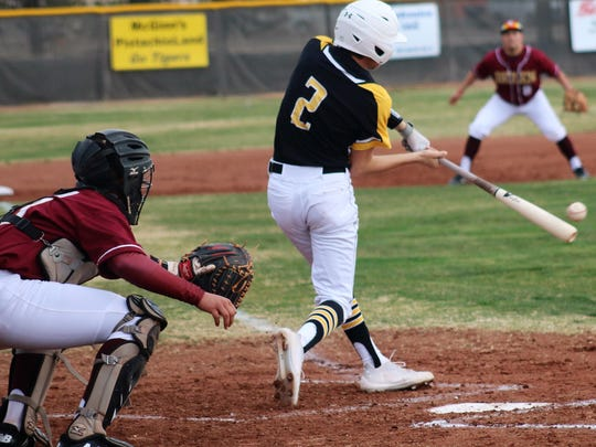 Alamogordo's Avery Mirabal makes contact with a pitch.