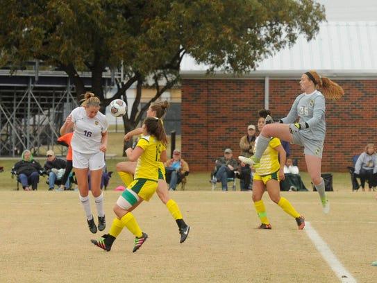 Hardin-Simmons senior Kirsten Parrish heads the ball