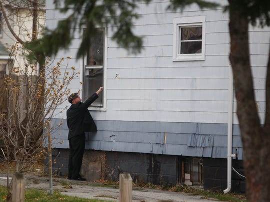 Rochester police investiagte a homicide at 26 Ludwig Park in a photo from November 2014.