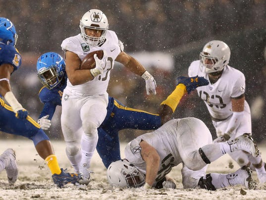 Bradshawís late touchdown lifts Army over Navy, 14-13