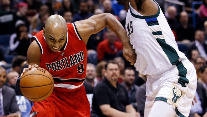 Milwaukee Bucks' O.J. Mayo, right, fouls Portland Trail Blazers' Gerald Henderson, left, as he drives during the first half of an NBA basketball game Monday, Dec. 7, 2015, in Milwaukee.