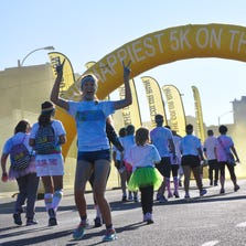 The streets of downtown St. Louis were painted pink, blue, yellow, and purple during The Color Run Saturday morning. Approximately 3,000 people came out for the 5K race that benefited Food Outreach and the St. Louis Chapter of Autism Speaks.