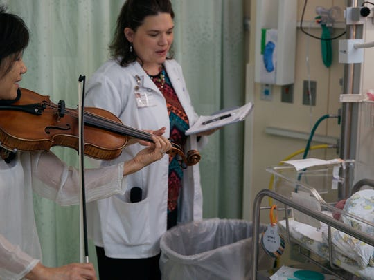 The Knoxville Symphony Orchestra's Music & Wellness Program, in which musicians perform at places that include the University of Tennessee Medical Center, is working to raise funds that will help them earn a grant.
