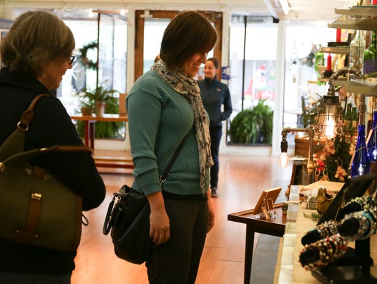 Rhonda George, left, and Lindsay Baker shop Saturday at The Foundry on Small Business Saturday in 2015.