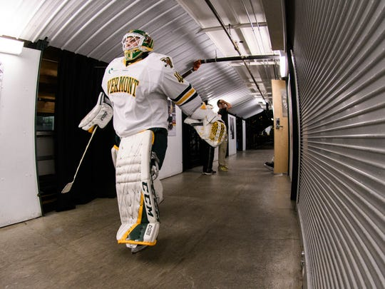 Vermont goalie Stefanos Lekkas (40) heads to the ice