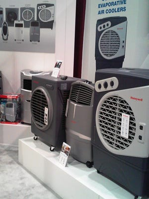Portable evaporative coolers for outdoor use on exhibit at this year's National Hardware show.
