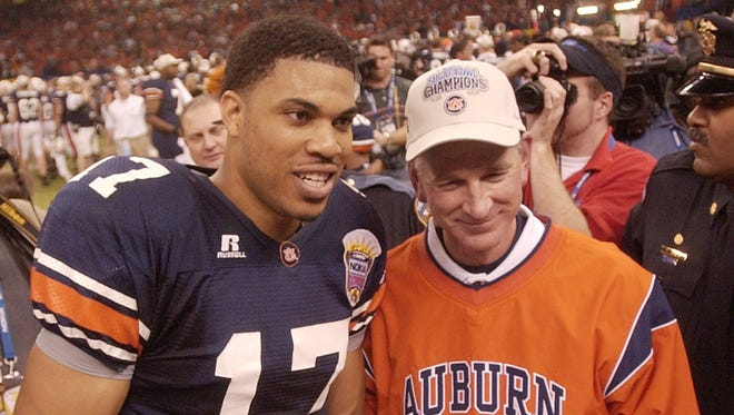 Sugar Bowl MVP Jason Campbell and head coach Tommy Tuberville after Auburn's 16-13 win vs. Virginia Tech in the Sugar Bowl on Jan. 3, 2005.