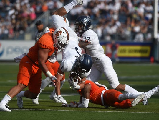 Nevada's McLane Mannix (1) gets up ended while taking