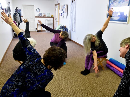 Wendy Masterson, far right, teaches her Gyrokinesis class on Wednesday at her studio, Motion Space.