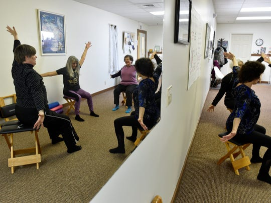 Wendy Masterson, far left, teaches her Gyrokinesis class on Wednesday at her studio, Motion Space.