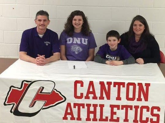Canton senior Chloe Homco (second from left) signed to play volleyball at Olivet Nazarene. Joining her on National Signing Day are parents Steve, Carol and younger brother Joshua.
