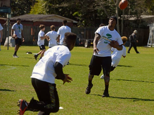 Damarious Randall of the Green Bay Packers works with kids Saturday during the Josh Sitton Football Camp at Catholic High School.