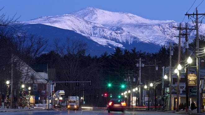 Mount Washington is seen at dawn from North Conway, New Hampshire. The owners of the Mount Washington Cog Railway that climbs to the highest peak in the Northeast want to build an upscale hotel a mile from the summit, in keeping with hotels that once graced the mountain in the 1800s. The owners say lodging would be open from April to November.