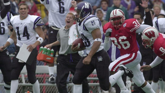 Northwestern tailback Damien Anderson breaks free for a 69-yard touchdown run against Wisconsin in the 2000 Big Ten opener at Camp Randall Stadium.