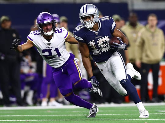Nov 10, 2019; Arlington, TX, USA; Dallas Cowboys receiver Amari Cooper (19) runs after a reception in the fourth quarter against Minnesota Vikings cornerback Mike Hughes (21) at AT&T Stadium. Mandatory Credit: Matthew Emmons-USA TODAY Sports
